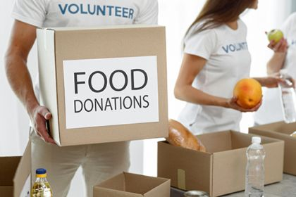 volunteer-holding-box-with-provisions-charity-sml.jpg